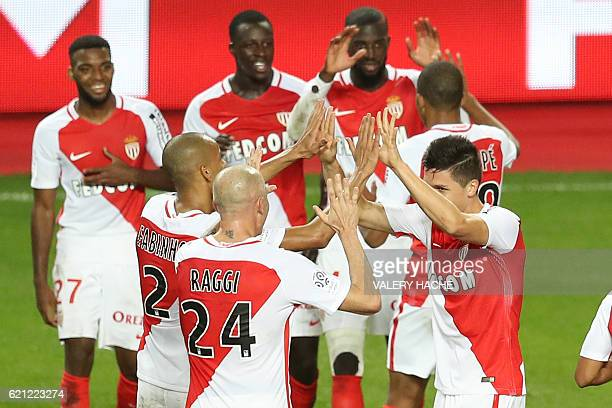 Monaco's Argentinian forward Guido Carrillo celebrates with teammates after scoring a goal during the French L1 football match Monaco vs Nancy on...