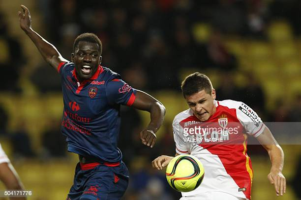 Monaco's Argentinian forward Guido Carrillo vies with Ajaccio's French Senegalese defender Kader Mangane during the French L1 football match Monaco...