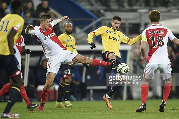 Monaco's Argentinian forward Guido Carrillo vies with FC Sochaux' French midfielder Johann Ramare during the French League Cup football match Sochaux...