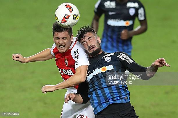 Monaco's Argentinian forward Guido Carrillo vies with Nancy Uruguayan defender Erick Cabaco Almada during the French L1 football match Monaco vs...