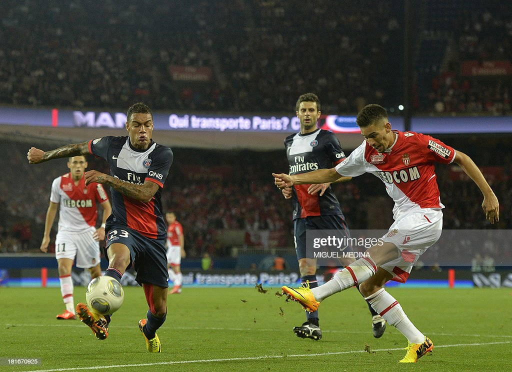 Monaco's Belgian midfielder Yannick Ferreira Carrasco (R) strikes in front of Paris Saint-Germain's Dutch defender Gregory Van der Wiel during the French L1 football match between Paris Saint-Germain and AS Monaco at the Parc des Princes Stadium in Paris on September 22, 2013.