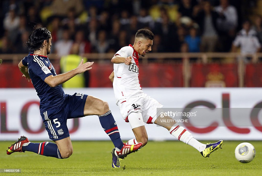 Monaco's Belgian midfielder Yannick Ferreira Carrasco (L) vies with Lyon's Serbian defender Milan Bisevac (L) during the French L1 football match Monaco (ASM) vs Lyon (OL) on October 27, 2013 at the Louis II Stadium in Monaco.