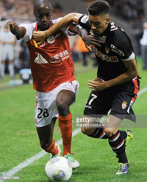 Monaco's Belgian midfielder Yannick Ferreira Carrasco vies with Reims' French forward Antoine Conte during the French L1 football match between Reims...