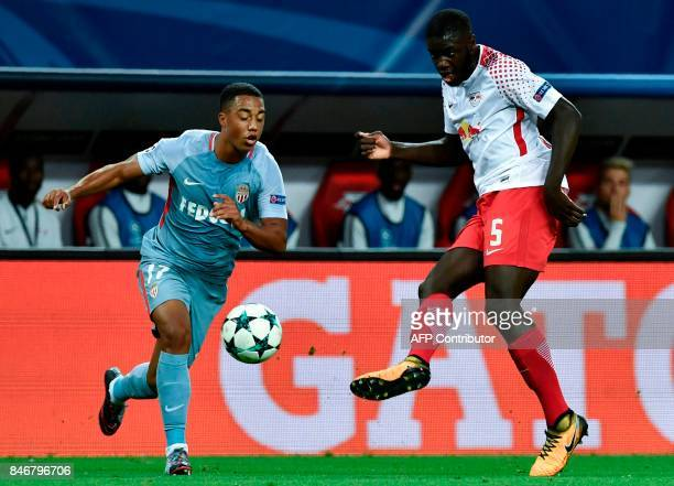 Monaco's Belgian midfielder Youri Tielemans and RB Leipzig's defender from France Dayot Upamecano vie for the ball during the UEFA Champions League...