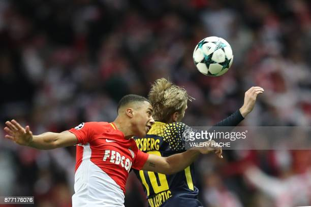 Monaco's Belgian midfielder Youri Tielemans heads the ball during the UEFA Champions League group G football match between Monaco and Leipzig at the...