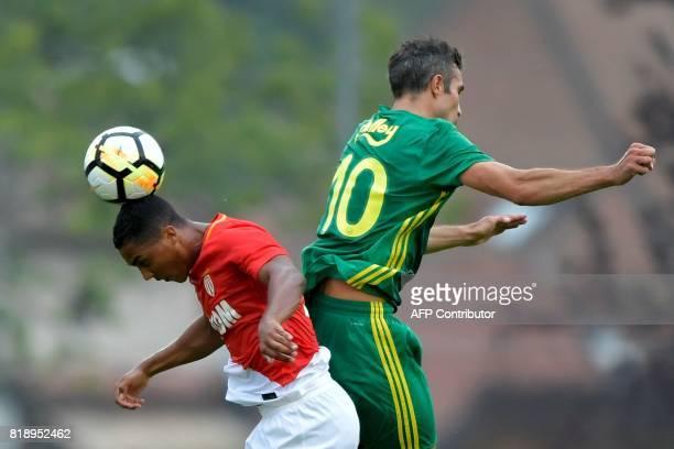 Monaco's Belgian midfielder Youri Tielemans heads the ball next to Fenerbahce's Dutch forward Robin van Persie during a friendly football match...