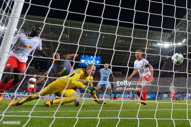 Monaco's Belgian midfielder Youri Tielemans scores the 11 goal past Leipzig's Hungarian goalkeeper Peter Gulacsi during the UEFA Champions League...
