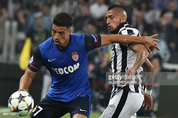 Monaco's Belgian Moroccan midfielder Nabil Dirar vies with Juventus' midfielder from Chile Arturo Vidal during the UEFA Champions League quarter...