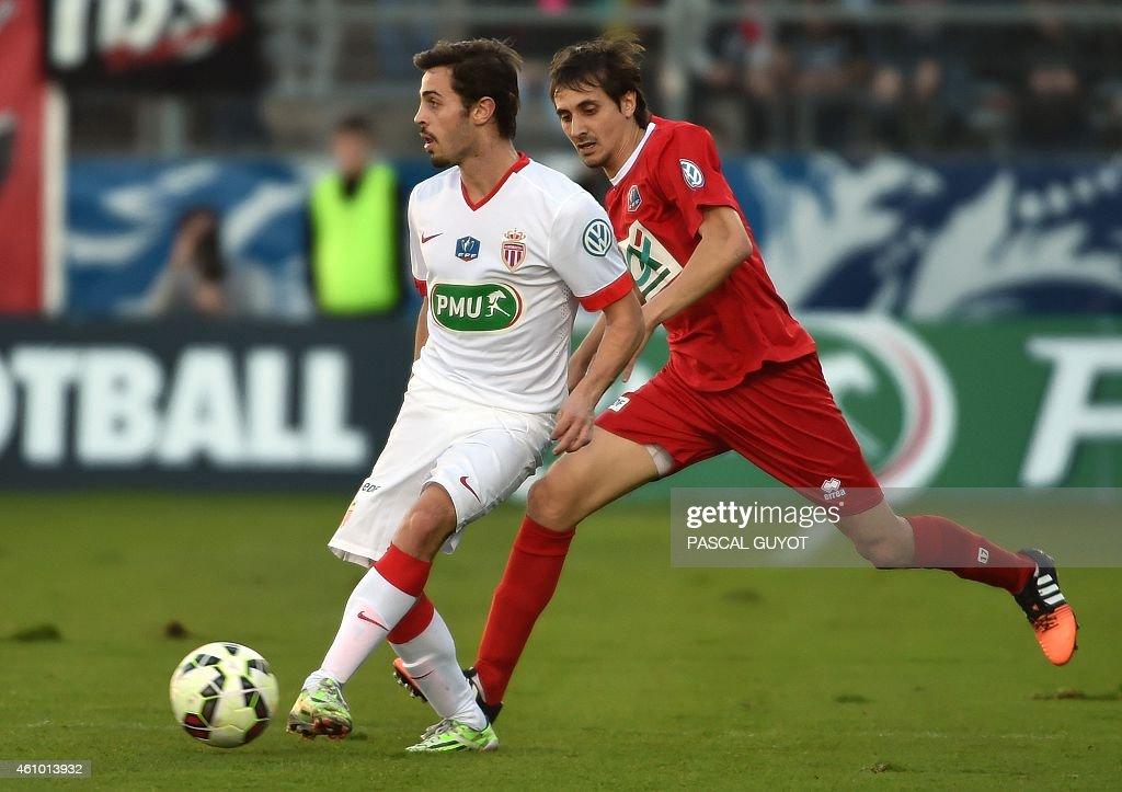 Monaco's Bernardo vies with Nîmes's Algerian defender Fethi Harek during the French Cup football match Nîmes vs Monaco on January 04 2015 at the...