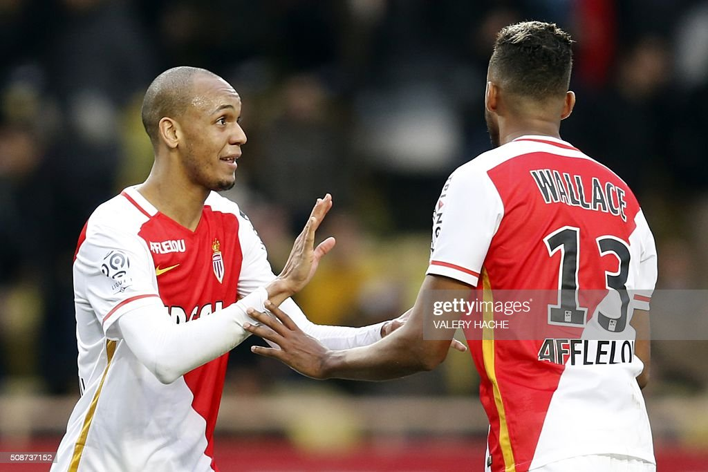 Monaco's Brazilian defender Fabinho (L) and Monaco's Brazilian defender Fortuna Dos Santos Wallace celebrate at the end of the French L1 football match between Monaco (ASM) and Nice (OGCN) at Louis II Stadium in Monaco on February 6, 2016. AFP PHOTO / VALERY HACHE / AFP / VALERY HACHE