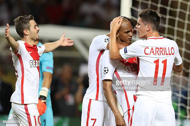 Monaco's Brazilian defender Fabinho celebrates after scoring a goal with teammate forward Guido Carrillo during the UEFA Champions League second leg...