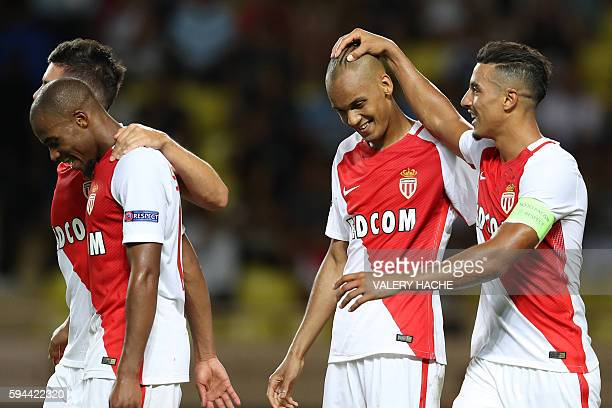 Monaco's Brazilian defender Fabinho celebrates after scoring a goal with teammates during the UEFA Champions League second leg play off football...