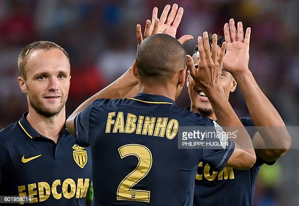 Monaco's Brazilian defender Fabinho celebrates after scoring a goal with team mates during the French L1 football match between Lille OSC and AS...