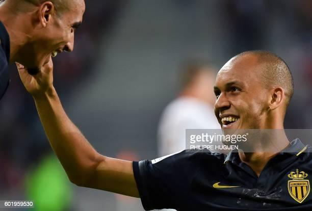 Monaco's Brazilian defender Fabinho celebrates after scoring a goal with Monaco's Moroccan midfielder Nabil Dirar during the French L1 football match...
