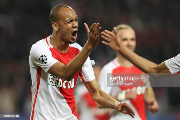Monaco's Brazilian defender Fabinho celebrates after scoring a goal during the UEFA Champions League round of 16 football match between Monaco and...