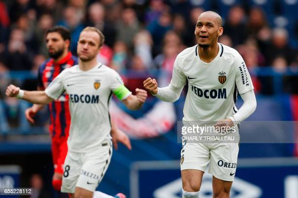 Monaco's Brazilian defender Fabinho celebrates after scoring a goal during the French L1 football match between Caen and Monaco on March 19 2017 at...