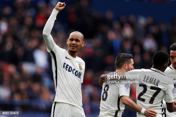 Monaco's Brazilian defender Fabinho celebrates after scoring a penalty kick during the French L1 football match between Caen and Monaco on March 19...