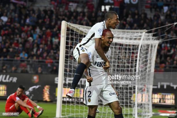 Monaco's Brazilian defender Fabinho celebrates with Monaco's French forward Kylian Mbappe Lottin after scoring the French L1 football match between...