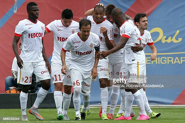 Monaco's Brazilian defender Fabinho celebrates with teammates after scoring a penalty during the French L1 football match between GFC Ajaccio and...
