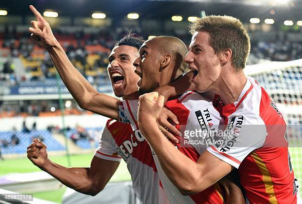 Monaco's Brazilian defender Fabinho celebrates with teammates after scoring a penalty during the French L1 football match between Montpellier and...