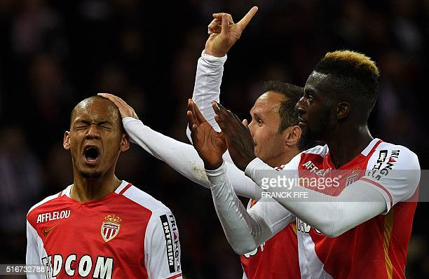 Monaco's Brazilian defender Fabinho celebrates with teammates after scoring a goal during the French L1 football match between Paris SaintGermain and...