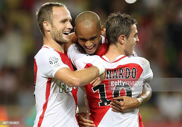 Monaco's Brazilian defender Fabinho celebrates with teammates after scoring a goal during the French Ligue 1 football match Monaco versus...