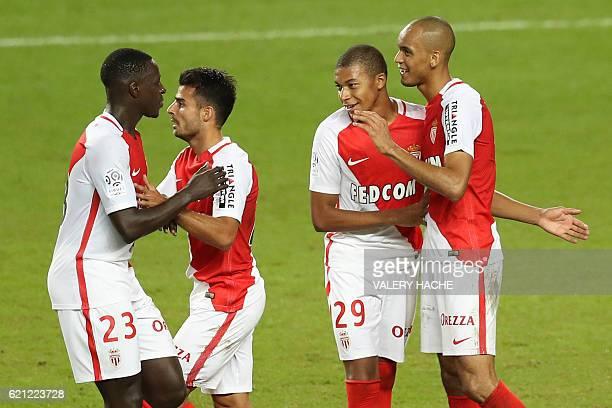 Monaco's Brazilian defender Fabinho celebrates with teammates after scoring a goal during the French L1 football match Monaco vs Nancy on November 5...