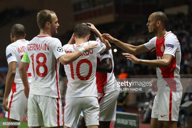 Monaco's Brazilian defender Fabinho celebrates with teammates after scoring a goal during the UEFA Champions League round of 16 football match...