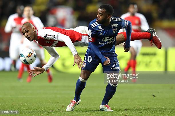 TOPSHOT Monaco's Brazilian defender Fabinho heads the ball next to Lyon's French forward Alexandre Lacazette during the French L1 football match...