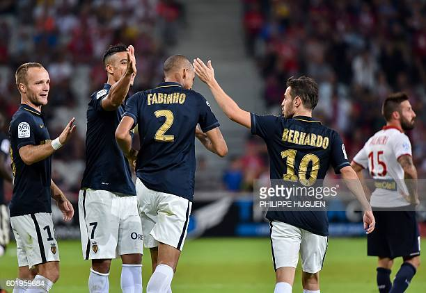 Monaco's Brazilian defender Fabinho is celebrated by team mates after scoring a goal during the French L1 football match between Lille OSC and AS...