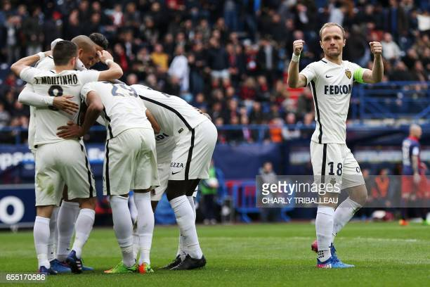 Monaco's Brazilian defender Fabinho is congratulated by teammates after scoring a penalty kick during the French L1 football match between Caen and...