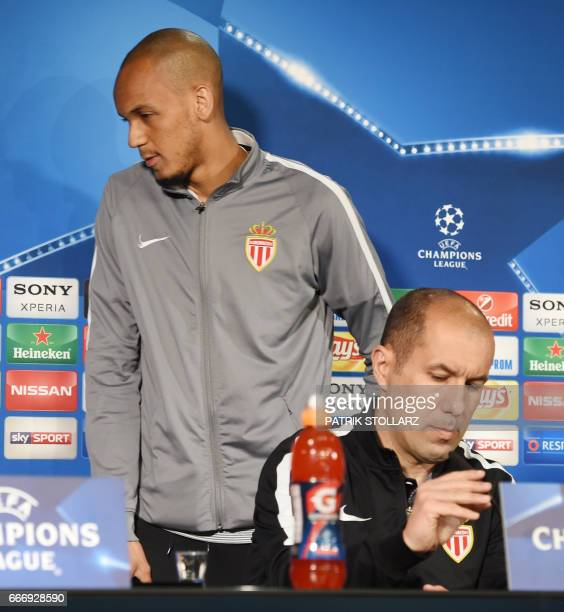 Monaco's Brazilian defender Fabinho passes by Monaco's Portuguese coach Leonardo Jardim during a press conference in Dortmund western Germany on...