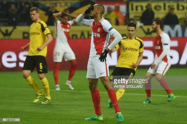 Monaco's Brazilian defender Fabinho reats after missing a penalty during the UEFA Champions League 1st leg quarterfinal football match BVB Borussia...