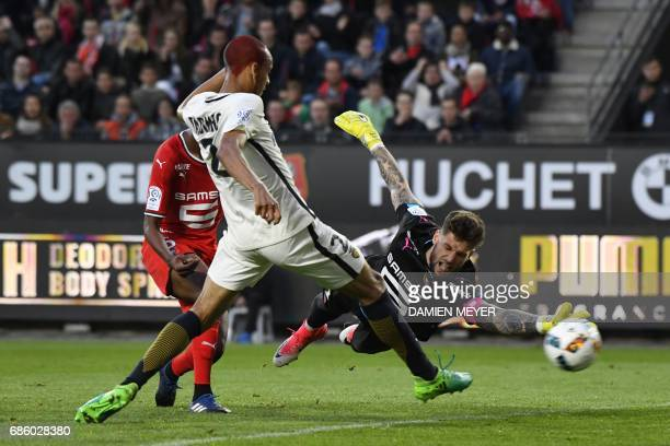 Monaco's Brazilian defender Fabinho scores a goal past Rennes' French goalkeeper Benoit Costil during the French L1 football match between Rennes and...