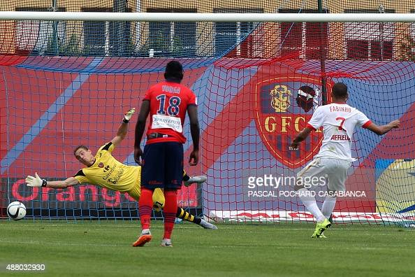 Monaco's Brazilian defender Fabinho scores a penalty during the French L1 football match between GFC Ajaccio and Monaco on September 13 2015 at the...