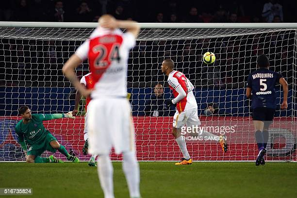 Monaco's Brazilian defender Fabinho scores a penalty during the French L1 football match between Paris SaintGermain and AS Monaco at the Parc des...