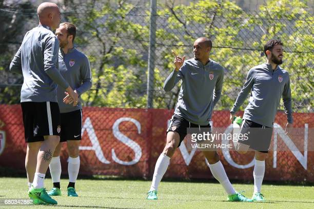 Monaco's Brazilian defender Fabinho speaks to Monaco's Italian defender Andrea Raggi during a training session on May 8 2017 in La Turbie near Monaco...
