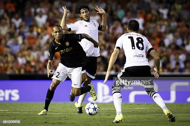 Monaco's Brazilian defender Fabinho Tavares vies with Valencia's Spanish midfielder Daniel Parejo during the UEFA Champions League playoff football...
