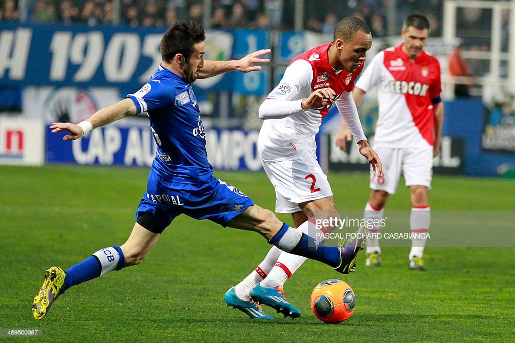 Monaco's Brazilian defender Fabinho vies with Bastia's French defender Julian Palmieri during the French L1 football match Bastia (SCB) against Monaco (ASM) in the Armand Cesari stadium in Bastia, Corsica, on February 15 , 2014.