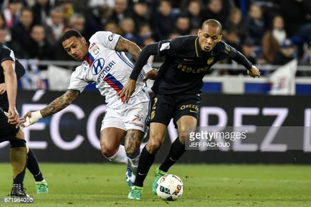 Monaco's Brazilian defender Fabinho vies with Lyon's Dutch forward Memphis Depay during the French L1 football match Olympique Lyonnais vs AS Monaco...