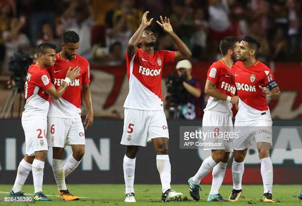 Monaco's Brazilian defender Jemerson celebrates with teammates after scoring a goal during the French L1 football match between Monaco and Toulouse...