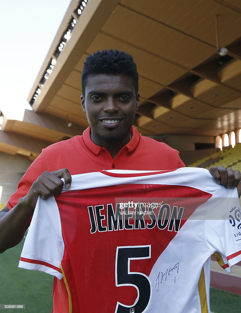 http://media.gettyimages.com/photos/monacos-brazilian-defender-jemerson-holds-up-his-new-team-shirt-on-4-picture-id508361386
