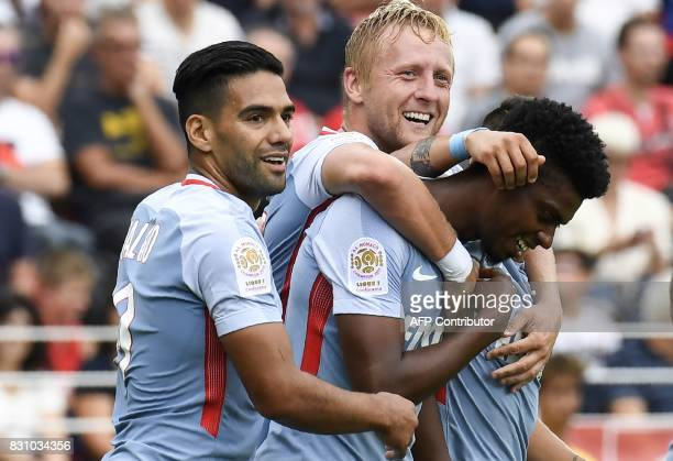 Monaco's Brazilian defender Jemerson is congratuled by teammates Monaco's Colombian forward Radamel Falcao and Monaco's Polish defender Kamil Glik...