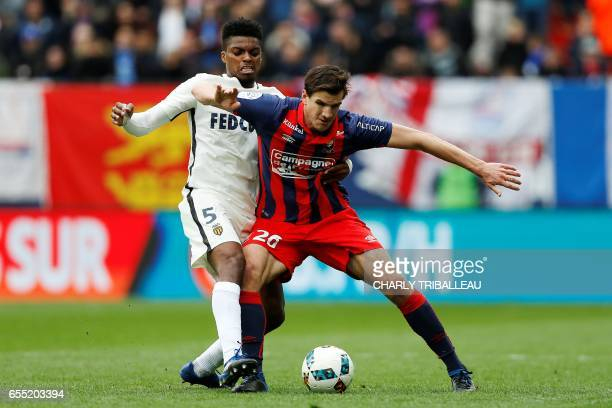 Monaco's Brazilian defender Jemerson vies with Caen's Croatian forward Ivan Santini during the French L1 football match between Caen and Monaco on...