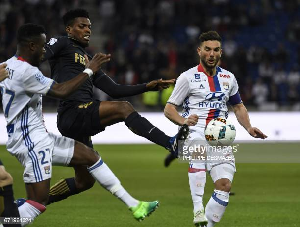 Monaco's Brazilian defender Jemerson vies with Lyon's French midfielder Jordan Ferri and Lyon's French forward Maxwel Cornet during the French L1...