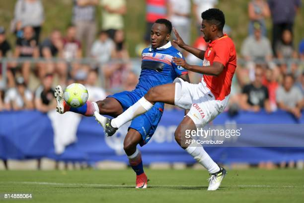 Monaco's Brazilian defender Jemerson vies with Stoke City's English striker Saido Berahino during a friendly football match between AS Monaco and...