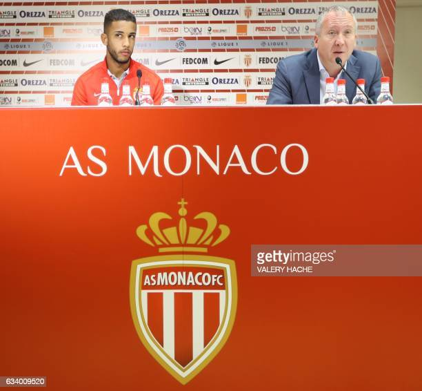 Monaco's Brazilian defender Jorge looks on next to Monaco's Russian Vice club President Vadim Vasilyev during the press conference of his official...