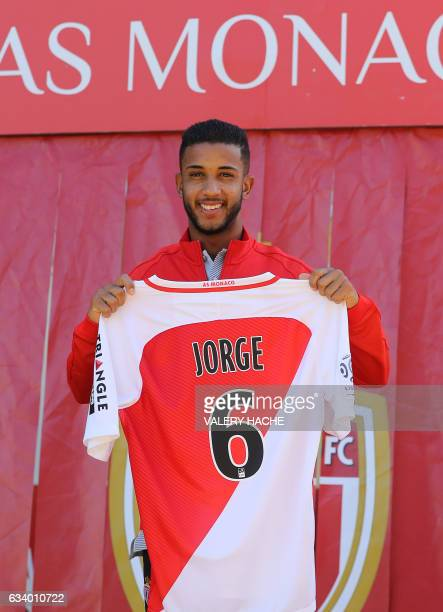 Monaco's Brazilian defender Jorge poses with his jersey during his official presentation at the AS Monaco football team on February 6 2017 at the...