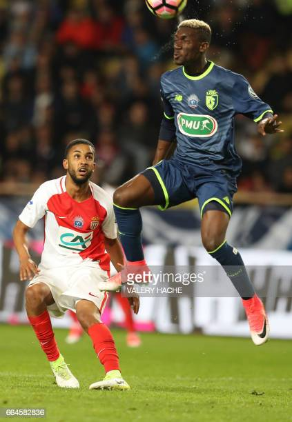 Monaco's Brazilian defender Jorge vies with Lille's Malian Yves Bissouma during the French Cup football match between Monaco vs Lille at the 'Louis...
