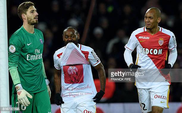 Monaco's Brazilian forward Vagner Love celebrates with teammate Fabinho next to Paris SaintGermain's German goalkeeper Kevin Trapp after scoring a...